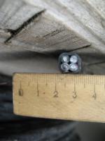 Фото силового алюминиевого кабеля АВВГ 3х6+1х4 для трёхфазной сети на деревянном барабане
