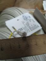 Фотография сечения авиационного теплостойкого провода ПТЛ-200 сечением 1,5