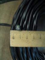 Фотография сечения медного силового двухжильного кабеля ВВГнг-LS 2х2,5 для стационарной прокладки электропроводки в общественных помещениях