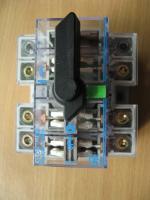 Фотография рубильника с дугогасительными камерами Dilos 1 на ток 100А корпорации GE