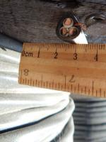 Внешний вид силового медного кабеля ВВГнг-LS 3х10 для групповой прокладки в общественных и жилых помещениях
