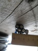 Фотография сечения алюминиевого четырёхжильного самонесущего провода СИП 4х25