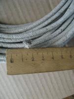Фотография жаростойкого провода ПАЛ 2,5 с одной медной жилой в асбестовой изоляции и в оплётке из асбестовой пряжи