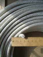 Фотография жаростойкого провода ПАЛ 10 с одной медной жилой в асбестовой изоляции и оплётке из асбестовой пряжи завода Уралкабель