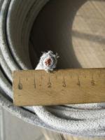 Фотография жаростойкого провода ПАЛ 16 с одной медной жилой в асбестовой изоляции и лёгком защитном покрове
