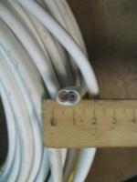 Фотография плоского гибкого кабеля ШВВП 2х4 с двумя медными жилами для электропроводки выпуска Южкабель