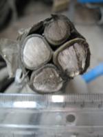 Фотография сечения силового алюминиевого кабеля АВВГнг 3х150+1х70 для стационарной групповой прокладки