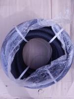 Фотография бухты чёрной гибкой гофрированной трубы из полиэтилена низкого давления диаметром 40 мм для заливки в бетон