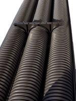 Изображение жёсткой усиленной гофрированной трубы с двумя стенками из полиэтилена диаметром 200 мм изготовления ДКС